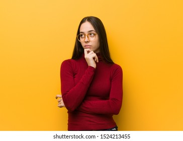 Intellectual young girl thinking about an idea
