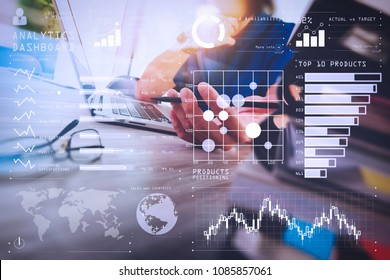 Intelligence (BI) and business analytics (BA) with key performance indicators (KPI) dashboard concept.designer hand working with digital tablet and laptop computer and book stack and eye glass.