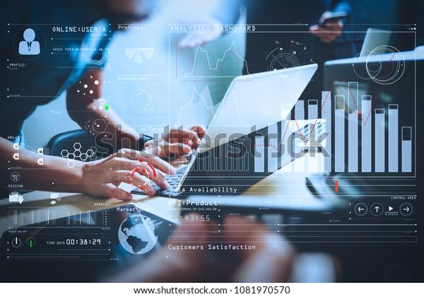 Intelligence (BI) and business analytics (BA) with key performance indicators (KPI) dashboard concept.StartUp Programming Team. Website designer working digital tablet dock keyboard.
