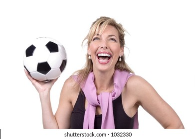 Intelligent 30s woman laughing and holding a soccer ball