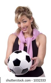 Intelligent 30s woman with soccer ball