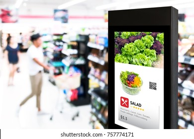 Intelligent Digital Signage , Augmented reality marketing and face recognition concept. Interactive artificial intelligence digital advertisement in retail hypermarket Mall.