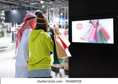 Intelligent Digital Signage , Augmented reality marketing and face recognition concept. Interactive artificial intelligence digital advertisement and customer shopping in fashion retail shopping Mall.