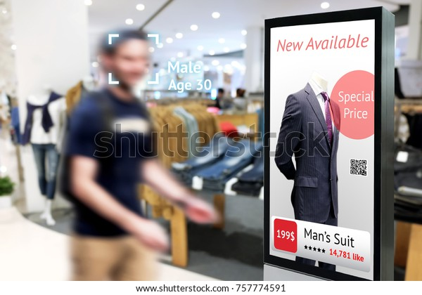 Intelligent Digital Signage , Augmented reality marketing and face recognition concept. Interactive artificial intelligence digital advertisement in fashion retail shopping Mall.