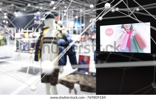 Intelligent Digital Signage in smart retail , Augmented reality marketing and face recognition concept. Interactive artificial intelligence digital advertisement in fashion retail shopping Mall.