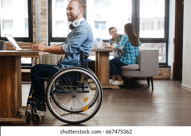 Intelligent handicapped student studying in a public place