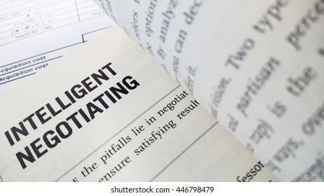 Intelligent negotiatiing word on the book with balance sheet as background