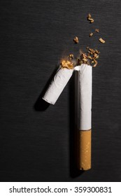 Intenational day : do not smoke today, May 31 - 2016.  End of flavored plug wrap cigarette Broken cigarette on black background, reflected, stop smoking