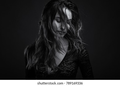 Intense beautiful woman portrait. Black and white image with film effect.