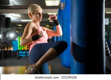 Intense fat burn exercise fitness routine kickboxing gym for self defense and independent strength