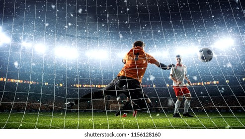 Intense soccer moment in front of the goal on the professional soccer stadium while it's snowing. Stadium and crowd are made in 3D.