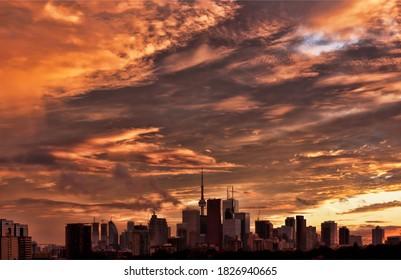 An intense sunset behind the Toronto skyline.