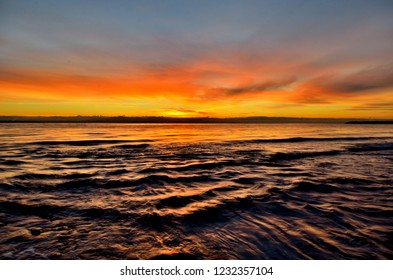 An intense sunset over the ocean on the sunshine coast in British Columbia