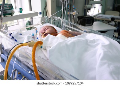 At the intensive care unit. Baby laying on a hospital bed and attached to a reviving apparatus. Press-tour to the Ukrainian Children's Cardiac Center for mass-media. May 18,2018. Kiev,Ukraine