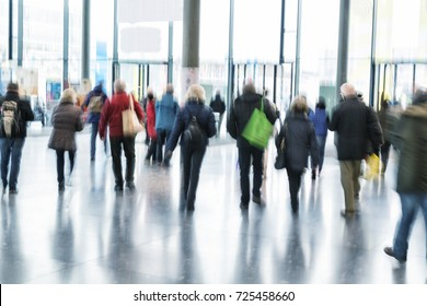 Intentional blurred image of people walking, blue toned image