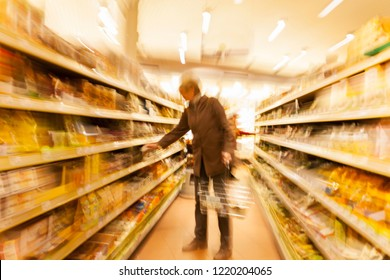 Intentional blurred image of woman in shopping center