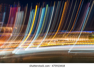 Intentional Camera Movement abstract shot of city lights in the night. Background for design.