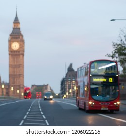 Intentionally blurred image of a double decker bus crossing Westminster Bridge in London at dawn. Big Ben and the Houses of Parliament