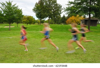 Intentionally Blurred Image of Girls Running at a High School Cross Country Meet
