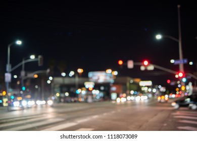Intentionally blurred image of an urban road with traffic in a big city environment.
