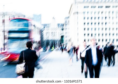 Intentionally overexposed blurred image of city commuters walking in London. Unrecognizable faces, bleached effect.
