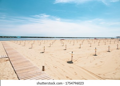 Intentionally overexposed shot of the beach of Bellaria Igea Marina, in the riviera Romagnola area on the Adriatic coast. Usually crowded, now deserted due to social distancing and sanitary emegency