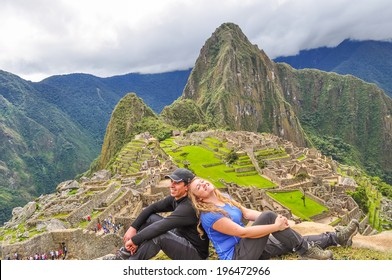 Inter ethnic couple of tourists on Sun Gate, (Machu Picchu, Peru)