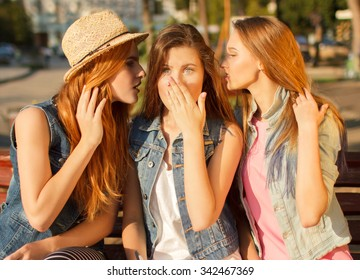 interaction between girls. it is photographed on the street