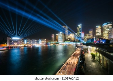 Interactive Lighting full color Laser Show at Vivid Festival 2018 in Sydney Harbour, Australia. The crowds enjoy the colorful lights that illuminate Sydney Skyline at Circular Quay.
