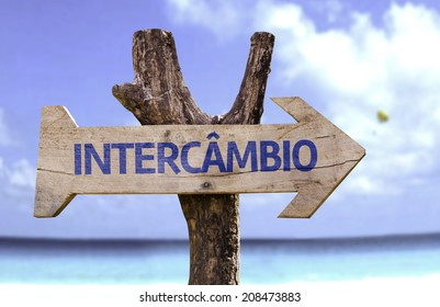 """""""Intercambio"""" (In portuguese - Student Exchange Program) wooden sign with a beach on background"""