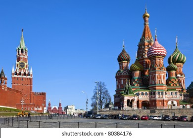 Intercession Cathedral (St. Basil's) and the Spassky Tower of Moscow Kremlin at Red Square in Moscow. Russia.