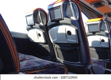 Intercity bus interior. Comfortable seats with monitors.