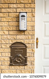 Intercom and mailbox built-in brick wall at the door of the apartment building