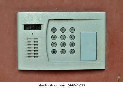 intercom system on old brown door