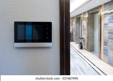 intercom video door bell on the wall outside modern corridor