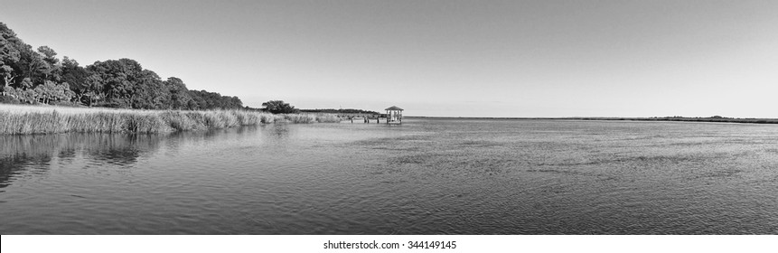 Inter-costal Waterway at Daufuskie Island overlooking the marsh and a dock in summer time Black and White/ Dock Adventure