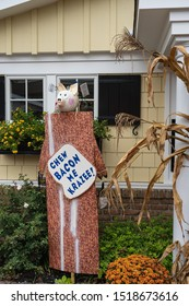 Intercourse, PA - Sept 28, 2019: This entry called Chew Bacon Me Krazee! in the Kitchen Kettle Village scarecrow contest is one of the pig & bacon themed scarecrows created by shops in the Village.