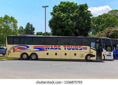 Intercourse, PA, USA - June 5, 2018: Tour buses that bring visitors and tourists are parked at the Kitchen Kettle complex in Lancaster County, PA.
