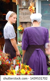 Intercourse, PA, USA September 18, 2006 Two Mennonite women shop at a garden center in Intercourse, Pennsylvania