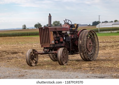 Intercourse, PA, USA - September 22, 2018: A tractor with metal wheels to curtail travel on public roads but useful in fields is parked at an Amish farm in Lancaster County, PA.