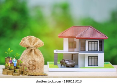Interest rates, Money bag and plant growing on gold coins money with miniature couple and model house on natural green background, Business investment and real estate concept