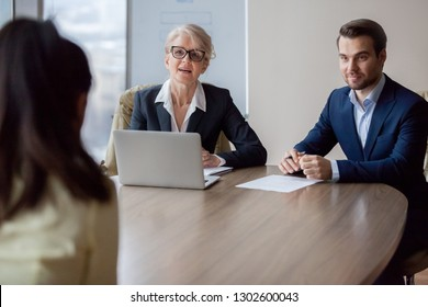 Interested hr managers focused on listening applicant at job interview, recruiters employers talking to seeker asking questions meeting vacancy candidate, staffing, hiring and recruitment concept