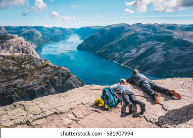 Interested people watching down from the top of the rock in Norway. Amazing view over the Lysefjord