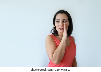 Interested pretty Caucasian woman looking and talking aside. Attractive middle aged woman gossiping. Sharing secrets concept.