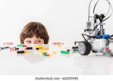 Interested sly male child glancing at toy