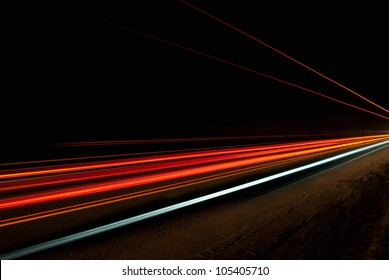 Interesting and abstract lights in a tunnel in orange that can be used as background or texture