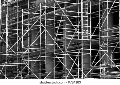interesting abstract of scaffolding around a building under construction