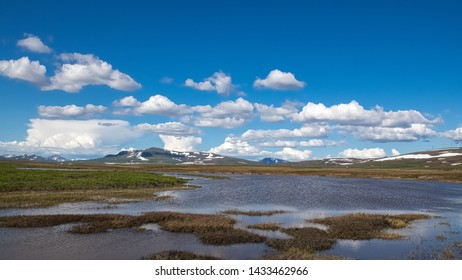 Interesting cloud formations and a wet tundra in Nome Alaska.