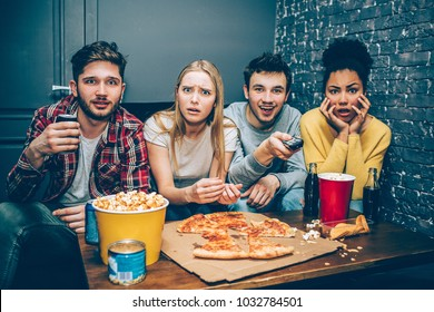 Interesting and emotional picture of teens watching the late night show full of horror and terrified things. The company is amazed and scared at the same time. They don't want to eat meal anymore.