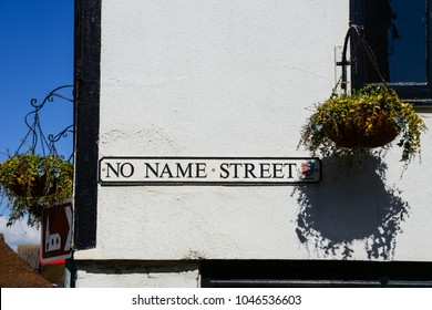 Interesting funny road name sign of no name street